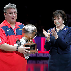 Apr 3, 2019; New Orleans, LA, USA;  New Orleans Pelicans owner Gayle Benson presents equipment manager David Jovanovic with with an award for his 30th season working in the NBA during the first quarter against the Charlotte Hornets at the Smoothie King Center. Mandatory Credit: Derick E. Hingle-USA TODAY Sports
