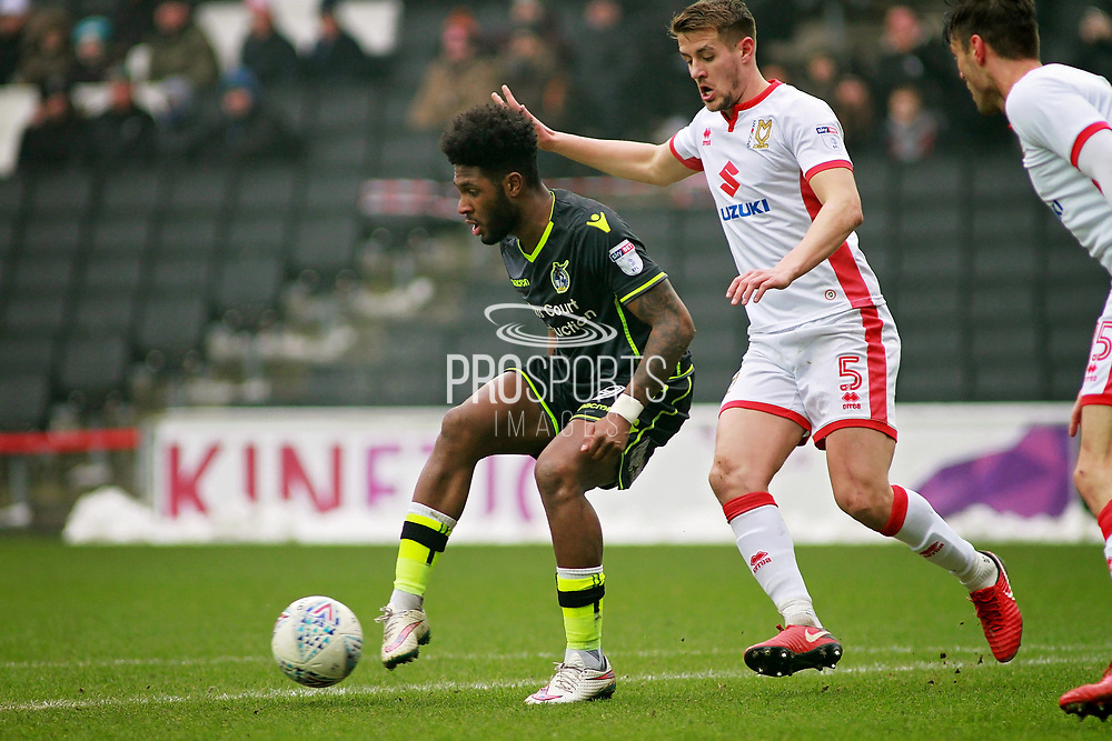 Bristol Rovers Ellis Harrison (9) and MK Dons Scott Wootton(5) during the EFL Sky Bet League 1 match between Milton Keynes Dons and Bristol Rovers at stadium:mk, Milton Keynes, England on 3 March 2018. Picture by Nigel Cole.
