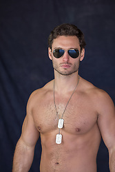 hot muscular Army man wearing sunglasses
