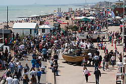 © Licensed to London News Pictures. 25/05/2014. Brighton, UK. People relaxing on the beach enjoying the sunshine. The May Bank Holiday Sunday has attracted thousands of people to visit the seaside resort and take to the beach.  Photo credit : Hugo Michiels/LNP