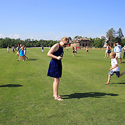 Polo fans of all ages replace divots in the turf, a traditional feature at half time during polo matches during the Airstream vs. Cinque Terre Polo match at the Greenwich Polo Club, Greenwich, Connecticut, USA. 23rd June 2013. Photo Tim Clayton