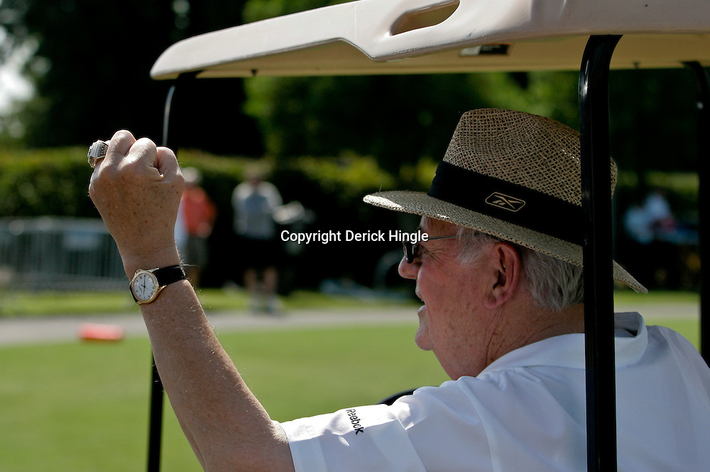 July 31, 2010; Metairie, LA, USA; New Orleans Saints owner Tom Benson shows his Super Bowl XLIV championship ring to fans during a training camp practice at the New Orleans Saints practice facility. Mandatory Credit: Derick E. Hingle