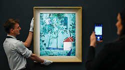 "© Licensed to London News Pictures. 22/11/2019. LONDON, UK. Technicians present ""Green Landscape"", circa 1926-27, by Yuri Annenkov (Est. GBP100-150k) at the preview for the upcoming sales of Russian artworks at Sotheby's New Bond Street.  The Russian Pictures and Works of Art, Fabergé and Icons sales take place on 26 November.  Photo credit: Stephen Chung/LNP"