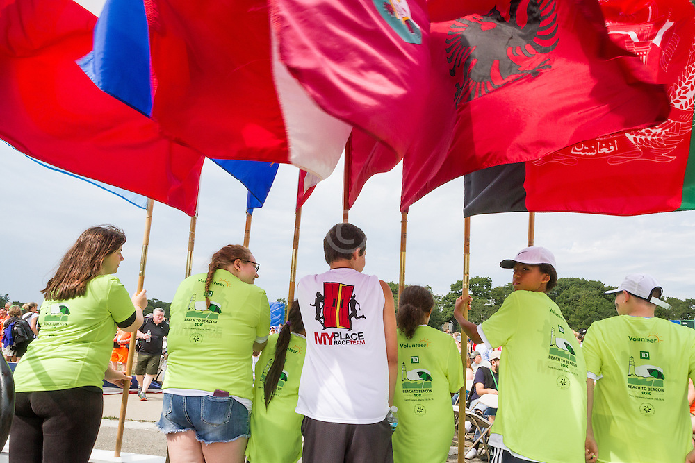 My Place kids hold flags of countries represented at the race