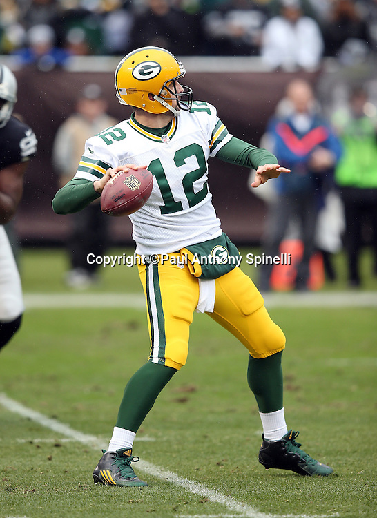 Green Bay Packers quarterback Aaron Rodgers (12) throws a deep pass during the 2015 week 15 regular season NFL football game against the Oakland Raiders on Sunday, Dec. 20, 2015 in Oakland, Calif. The Packers won the game 30-20. (©Paul Anthony Spinelli)