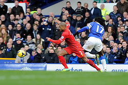 Everton's Romelu Lukaku and Liverpool's Glen Johnson chase down a loose ball - Photo mandatory by-line: Dougie Allward/JMP - Tel: Mobile: 07966 386802 23/11/2013 - SPORT - Football - Liverpool - Merseyside derby - Goodison Park - Everton v Liverpool - Barclays Premier League