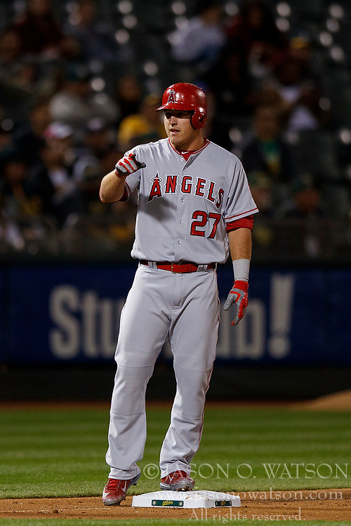OAKLAND, CA - APRIL 04:  Mike Trout #27 of the Los Angeles Angels of Anaheim celebrates after hitting a triple against the Oakland Athletics during the fifth inning at the Oakland Coliseum on April 4, 2017 in Oakland, California. The Los Angeles Angels of Anaheim defeated the Oakland Athletics 7-6. (Photo by Jason O. Watson/Getty Images) *** Local Caption *** Mike Trout