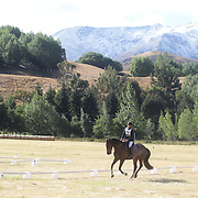 Verona Mitchell riding Soverign Fern in action during the Dressage event with the stunning backdrop of The Remarkables Mountain Range at the Wakatipu One Day Horse Trials,  Queenstown, Otago, New Zealand. 15th January 2012. Photo Tim Clayton