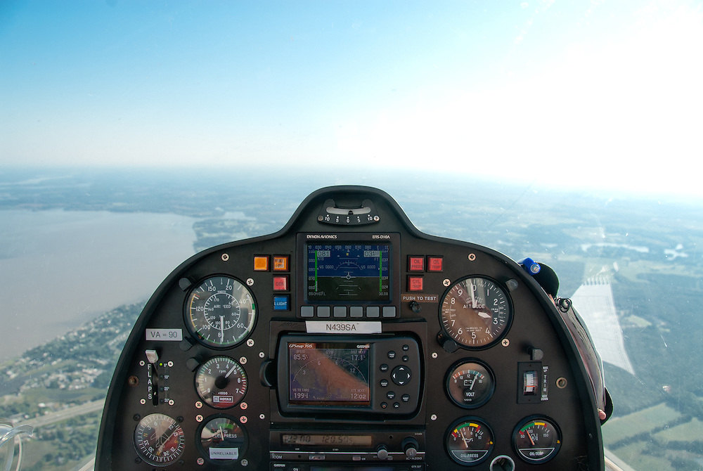 Cockpit of a small plane overlooking landscape of Eastern Shore of Maryland