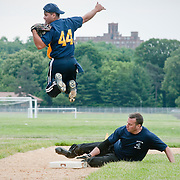 June 9, 2010 - Bronx, NY : The fields at Van Cortlandt Park are finally open to the public again after well over a year of construction.  On June 9, the NYPD turned out to compete in a city-wide charity softball tournament. The 50th precinct's Ray Farrelly slides into third base as the SBA's Xavier Morales goes airborne.
