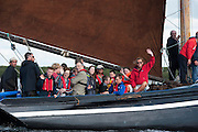 10/08/2014 Attorney general Attorney General, Máire Whelan SC, waves from AN Capaill , a Galway Hooker who in keeping with tradition brought turf in a Galway hooker from Connemara to Kinvara during the annual Crinniu na mBad Festival. Photo:Andrew Downes