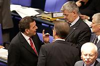 17 OCT 2003, BERLIN/GERMANY:<br /> Gerhard Schroeder (L), SPD, Bundeskanzler, Franz Muentefering (M), SPD Generalsekretaer, und Joschka Fischer (R), B90/Gruene, Bundesaussenminister, im Gespraech, waehrend einer namentlichen Abstimmung, Plenum, Deutscher Bundestag<br /> IMAGE: 20031017-01-120<br /> KEYWORDS: Gerhard Schröder, Franz Müntefering, Gespräch