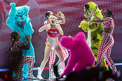 © Licensed to London News Pictures. 06/05/2014. London, UK.   Miley Cyrus performing live at The O2 Arena for the first date of the European leg of her Bangerz 2014 world tour.  Miley was hospitalised on April 15 after suffering an allergic reaction to antibiotics, causing the start of her European tour to be delayed from May 2nd.   Miley Cyrus is an American actress and singer. Photo credit : Richard Isaac/LNP