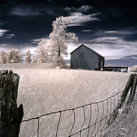 An old fence with a timber barn