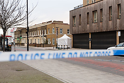 © Licensed to London News Pictures. 08/12/2017. London, UK. Police cordon and forensic tent at the scene of a fatal stabbing in Hackney, east London.  Emergency services attended an incident at the junction of Christie Road and Cassland Road at 4:45pm yesterday, following reports of a man suffering a stabbing injury. A man, believed to be in his late 20's died at the scene shortly afterwards. Photo credit: Vickie Flores/LNP