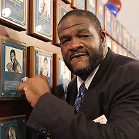 CANASTOTA, NY - JUNE 14: Boxing champion Riddick Bowe poses with his new ring and photo on the wall after the induction ceremony at the International Boxing Hall of Fame induction Weekend of Champions events on June 14, 2015 in Canastota, New York. (Photo by Alex Menendez/Getty Images) *** Local Caption *** Riddick Bowe
