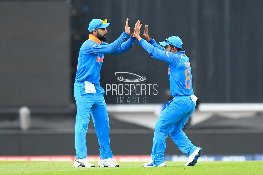 Wicket - Kedar Jadhav of India celebrates with Virat Kohli (captain) of India after taking the catch which dismissed Shoaib Malik of Pakistan during the ICC Champions Trophy final match between Pakistan and India at the Oval, London, United Kingdom on 18 June 2017. Photo by Graham Hunt.