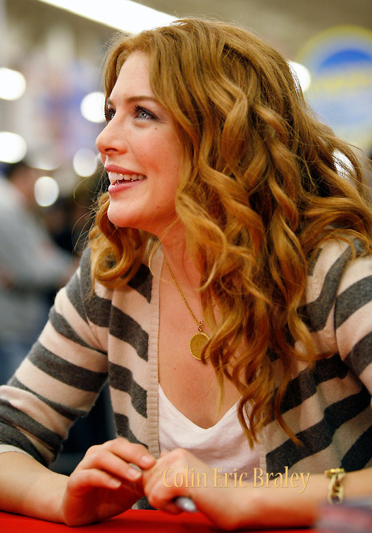 Twilight star Rachelle Lefevre, who plays character Victoria, smiles as she waits for the next fan during an autograph session at the Walmart store in Riverton, Utah during the midnight DVD movie release event March 21, 2009. (AP Photo/Colin Braley)