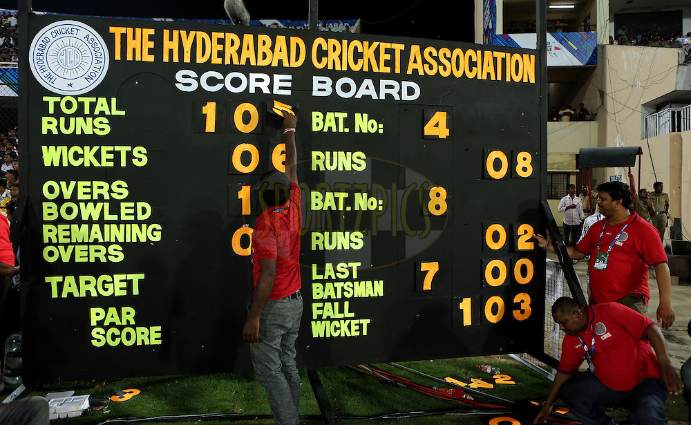 Manual Score board during match 7 of the Oppo Champions League Twenty20 between the Kolkata Knight Riders and the Lahore Lions held at the Rajiv Gandhi Cricket Stadium, Hyderabad, India on the 21st September 2014<br /> <br /> Photo by:  Sandeep Shetty / Sportzpics/ CLT20<br /> <br /> <br /> Image use is subject to the terms and conditions as laid out by the BCCI/ CLT20.  The terms and conditions can be downloaded here:<br /> <br /> http://sportzpics.photoshelter.com/gallery/CLT20-Image-Terms-and-Conditions-2014/G0000IfNJn535VPU/C0000QhhKadWcjYs