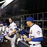 NEW YORK, NEW YORK - APRIL 27:  Neil Walker #20 of the New York Mets preparing to bat looks across to bench coach Dick Scott in the dugout during the New York Mets Vs Cincinnati Reds MLB regular season game at Citi Field on April 27, 2016 in New York City. (Photo by Tim Clayton/Corbis via Getty Images)