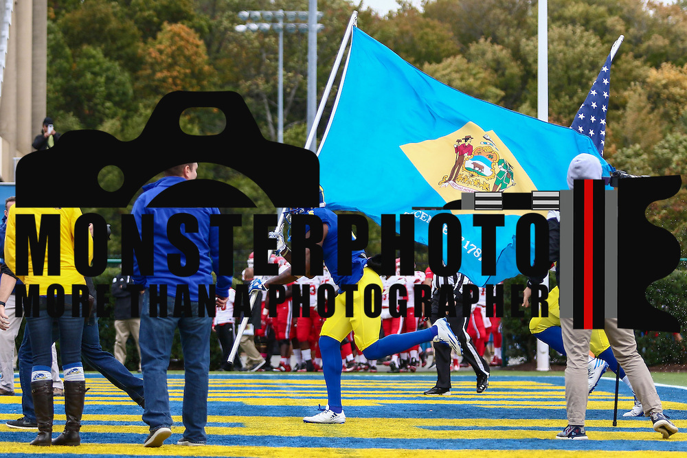 Delaware wide receiver JAMIE JARMON (6) carries the state flag onto the field prior to a week eight game between the Delaware Blue Hens and the Stony Brook Seawolves, Saturday, Oct. 22, 2016 at Tubby Raymond Field at Delaware Stadium in Newark, DE.