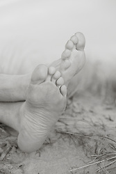 detail of a man's feet on the beach
