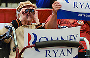 Anna Belle Carpenter, age 91 of Marion, Ohio uses binoculars to see Republican Presidential nominee Mitt Romney speak at a rally in Marion, Ohio, Oct. 28, 2012.
