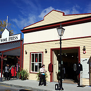 Arrowtown High Street in Autumn..Arrowtown is the much visited, historic, 4-season, southern hemisphere holiday destination, located only 20 minutes drive from Queenstown, South Island, New Zealand..Arrowtown is a former gold-mining town built on the banks of the Arrow River, once a rich source of gold in the 1860's and now a sophisticated, multi-cultural town catering visitors from around the globe. Arrowtown offers an ambiance with its shops, restaurants, cafes, offices and galleries located within a tight precinct.  5th April 2011.  Photo Tim Clayton.