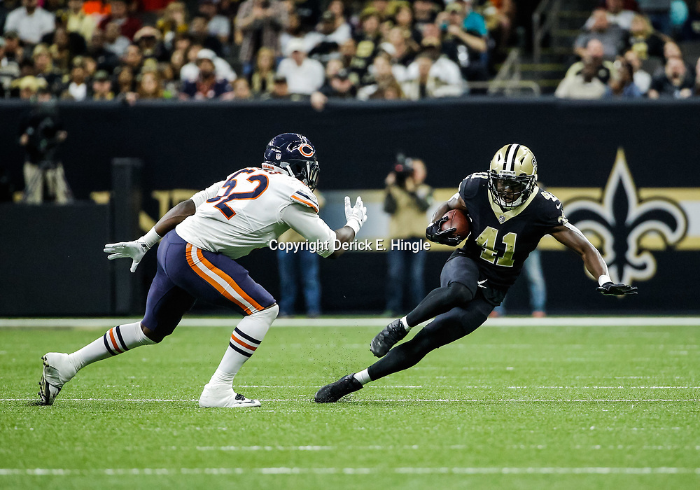 Oct 29, 2017; New Orleans, LA, USA; New Orleans Saints running back Alvin Kamara (41) runs from Chicago Bears linebacker Christian Jones (52) during the second half of a game at the Mercedes-Benz Superdome. The Saints defeated the Bears 20-12. Mandatory Credit: Derick E. Hingle-USA TODAY Sports