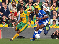Photo: Ashley Pickering.<br />Norwich City v Cardiff City. Coca Cola Championship. 21/10/2006.<br />Cardiff's Luigi Glombard holds off Norwich's Jurgen Colin.