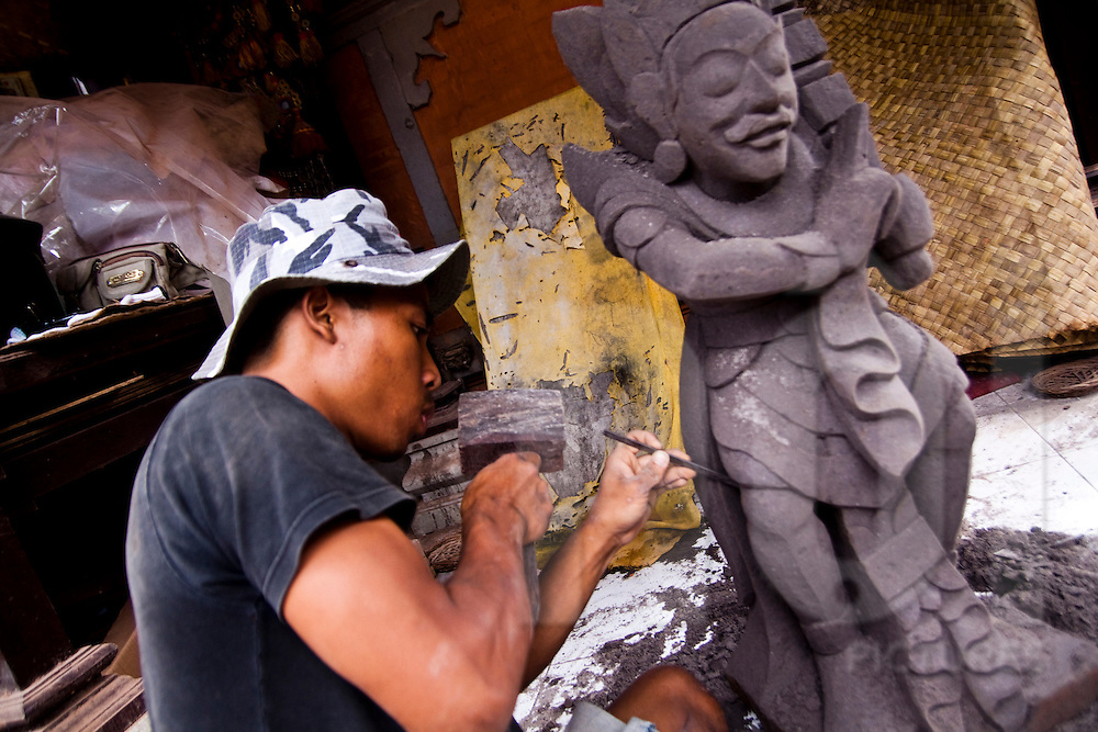 A man carves a statue during renovations of the Pura Malanting temple in Ubud, Bali, Indonesia, Southeast Asia