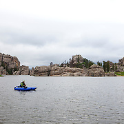 Fishing in Sylvan Lake. Custer State Park is a state park and wildlife reserve in the Black Hills of southwestern South Dakota. The park is South Dakota's largest and first state park, named after Lt. Colonel George Armstrong Custer.   Photography by Jose More