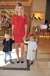 The COUNTESS OF MORNINGTON and her children MAE and DARCY at a fun filled tea party hosted by Roger Vivier to view their Jeune Fille collection of shoes in aid of Mothers4Children held at Roger Vivier, Sloane Street, London on 27th March 2012.