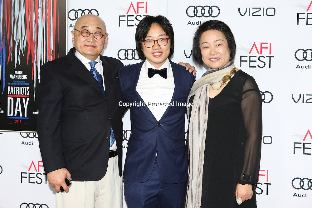 Actor Richard Ouyang (L) with actor Jimmy O. Yang and Amy Cheung attend the AFI Fest 2016 presented by AUDI closing night screening of Patriots Day at TCL Chinese Theatre, Hollywood, CA on November 17th