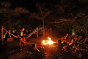 Yucatan Peninsula: Xcaret, Xel-Ha and Xplore parks. Shown: After zip lining, park visitors take a break around a campfire at Xplore. (June 2015/ photo by Essdras M Suarez/ EMS Photography©)