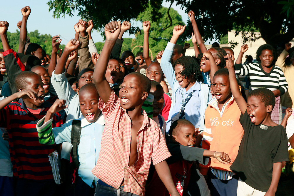 Children from the town of Matola cheer as Prime Minister Ali launches the week-long nationwide measles campaign in Mozambique, Monday, May 23, 2011. The campaign aims to vaccinate 3.6 million children under the age of 5 against measles with the ultimate goal of eliminating the disease from the country. (Stuart Ramson/Insider Images for UN Foundation)