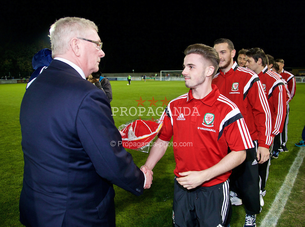 BANGOR, WALES - Friday, October 31, 2014: Wales development squad are presented with their caps during the Under-16's Victory Shield International match at the Nantporth Stadium. (Pic by David Rawcliffe/Propaganda)