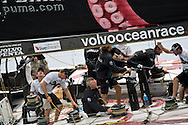 The crew of Puma Powered by Berg at the winches during the in-port race at 2011-2012 Volvo Ocean Race Miami.  Mar Mostro's graphics entwine the deck.