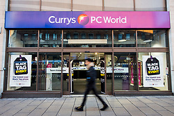 © Licensed to London News Pictures. 24/11/2017. Leeds, UK. Picture shows a shopper walking past PC world in Leeds this morning on Black Friday. Photo credit: Andrew McCaren/LNP