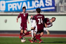 Petar Stojnic of Triglav and Robert Najdenov of Triglav during football match between NK Triglav Gorenjska and NK Olimpija in 27th Round of Slovenian 1st League PrvaLiga, on April 10, 2011 in Sports park Kranj, Slovenia. (Photo By Vid Ponikvar / Sportida.com)