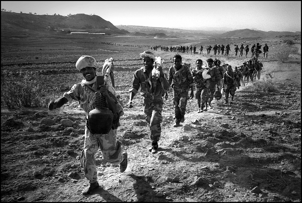 Eritrean soldiers marching off to war during their bloody 2-year border war with Ethiopia in which tens of thousands of people died and millions made homeless on both sides.