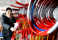January 30, 2018 - Lianyungan, Lianyungan, China - A worker at a racket factory in Donghai County, Lianyungang, east China's Jiangsu Province. The badminton and table tennis racket production industry booms in east China in recent years. (Credit Image: © SIPA Asia via ZUMA Wire)