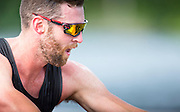 Conlin McCabe, 2012 Olympic silver medalist and now member of the Canadian mens rowing four that will represent Canada at the Rio Olympic games rows during a morning training session on Elk Lake in Victoria, British Columbia on June 22, 2016.