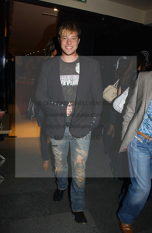 Singer DUNCAN JAMES at a party to launch Three's A Crowd held at the Mayfair Hotel, Berkley Street, London on 5th December 2006.<br />