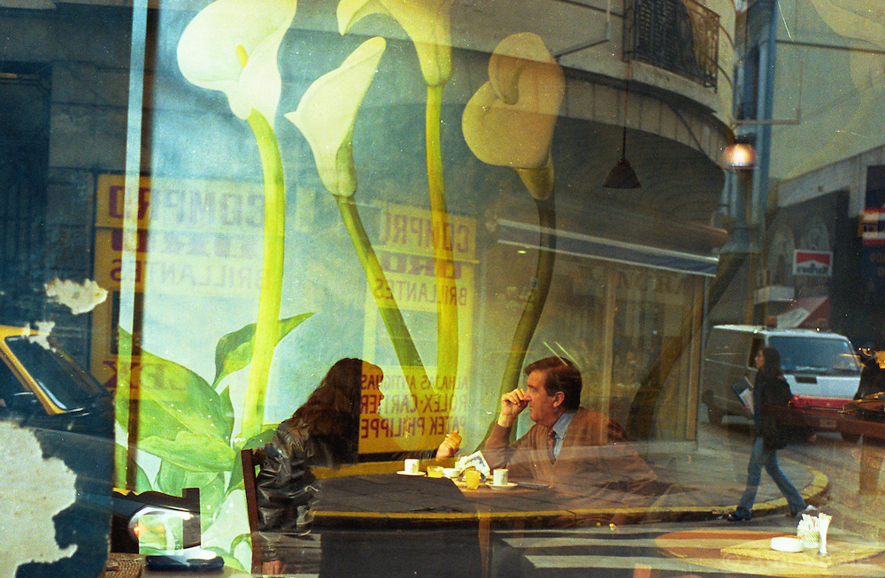 BUENOS AIRES, ARGENTINA:  A couple sit in a cafe in Buenos Aires. .(Photo by Ami Vitale)