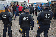 Calais, Pas-de-Calais, France - 18.10.2016    <br />  <br /> Police forces walk during a police operation through the &rdquo;Jungle&quot; refugee camp on the outskirts of the French city of Calais. Many thousands of migrants and refugees are waiting in some cases for years in the port city in the hope of being able to cross the English Channel to Britain. French authorities announced that they will shortly evict the camp where currently up to up to 10,000 people live.<br /> <br /> Polizisten gehen waehrend eines Einsatzes durch das &rdquo;Jungle&rdquo; Fluechtlingscamp am Rande der franzoesischen Stadt Calais. Viele tausend Migranten und Fluechtlinge harren teilweise seit Jahren in der Hafenstadt aus in der Hoffnung den Aermelkanal nach Gro&szlig;britannien ueberqueren zu koennen. Die franzoesischen Behoerden kuendigten an, dass sie das Camp, indem derzeit bis zu bis zu 10.000 Menschen leben K&uuml;rze raeumen werden. <br /> <br /> Photo: Bjoern Kietzmann