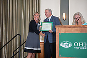 President Nellis congratulates Tammy Anderson on 10 years of service at the Classified Staff  Awards Ceremony.  Photo by Ben Siegel