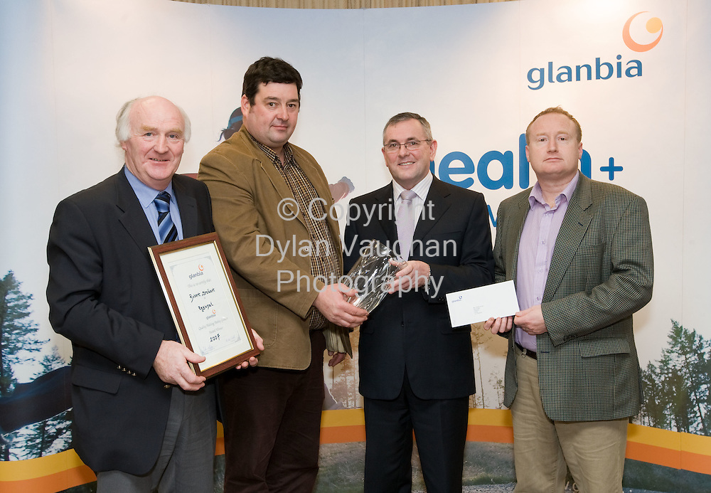 25/1/2008.free picture no charge for use.Pictured at Glanbia House in Kilkenny at the annual Grain Awards was from left Victor Quinlan, Vice Chairman Glanbia PLC, Robert Stuart, Gorey, Wicklow/North Wexford winner, John McGuinness TD, Junior Minister responsible for Trade and Commerce and Brendan Aherne, Regional Manager,Glanbia Agri-Business..Picture Dylan Vaughan.
