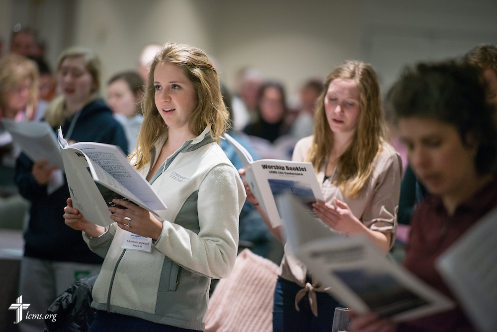 Adrienne Langwisch of Seward, Ne., sings during vespers at the Hilton Crystal City, Va., hotel following the 2015 March for Life Thursday, Jan. 22, 2015, in Washington, D.C.