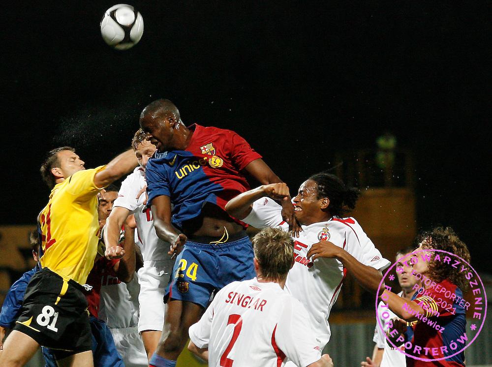 KRAKOW 26/08/2008.UEFA CHAMPIONS LEAGUE.THIRD QUALIFYING ROUND.SECOND LEG.WISLA KRAKOW v FC BARCELONA.NA ZDJ. MARIUSZ PAWELEK /WISLA/ AND YAYA TOURE /BARCELONA/.FOT. PIOTR HAWALEJ / WROFOTO.